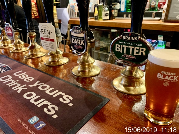A row of Brains hand pumps in The Cottage, Cardiff.